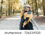 young beautiful woman in autumn ... | Shutterstock . vector #726219520
