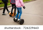 young woman riding hoverboard... | Shutterstock . vector #726229663