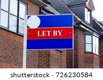 Small photo of Let by estate agency sign at homes for rent. Horizontal close up shot