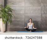 woman meditating in class. girl ... | Shutterstock . vector #726247588