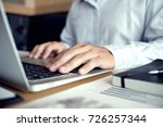 man working by using a laptop... | Shutterstock . vector #726257344