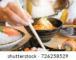 woman enjoy eating at a sushi... | Shutterstock . vector #726258529