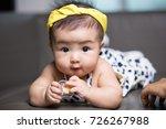 cute happy asian baby sucking... | Shutterstock . vector #726267988