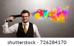 Small photo of Man shoots his head with gun and colorful splotch are coming out from his head