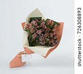 bouquet of flowers in green...   Shutterstock . vector #726308893