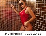 sexy girl in a red bathing suit ... | Shutterstock . vector #726311413