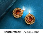 beautiful golden diwali diya... | Shutterstock . vector #726318400