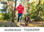 man walks in the park with the... | Shutterstock . vector #726343909