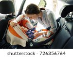 happy woman with infant seating ... | Shutterstock . vector #726356764