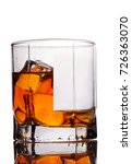 Small photo of Glass of scotch whiskey and ice on a white background.Concept half full,half empty