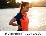 a girl in a sports suit is... | Shutterstock . vector #726417100