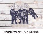 woolen sweater on wooden table. ... | Shutterstock . vector #726430108