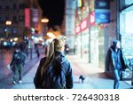 back view of girl walking on... | Shutterstock . vector #726430318