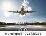 airplane lands on airport | Shutterstock . vector #726435298