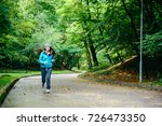 young pretty woman run utside... | Shutterstock . vector #726473350