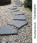 path of plated stones on gravel ... | Shutterstock . vector #726483694