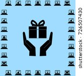 gift on the hands vector icon | Shutterstock .eps vector #726507430
