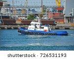 tugboat and crane in harbor... | Shutterstock . vector #726531193