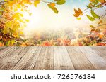 wooden table with autumn leaves ... | Shutterstock . vector #726576184