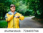 man measuring his pulse while... | Shutterstock . vector #726603766