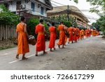 buddhist monks in a line in... | Shutterstock . vector #726617299