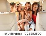 beautiful young women on back... | Shutterstock . vector #726653500