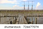 the wooden bridge is filed into ... | Shutterstock . vector #726677074