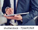 businessman holding digital...   Shutterstock . vector #726691969