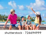happy beautiful family with... | Shutterstock . vector #726694999