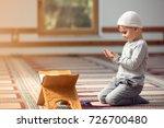 the muslim child prays in the...   Shutterstock . vector #726700480