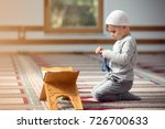 the muslim child prays in the... | Shutterstock . vector #726700633