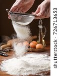 sifting flour with flour filter.... | Shutterstock . vector #726713653