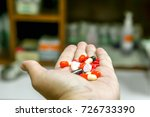 capsule and medicine tablet on... | Shutterstock . vector #726733390