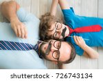funny man and kid with fake... | Shutterstock . vector #726743134