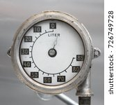Small photo of Old Vintage German Airplane Fuel gage, scale with an arrow, isolated, 0-85 liters.