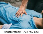 emergency cpr on a man who has... | Shutterstock . vector #726757123