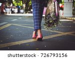 asian young woman carrying a... | Shutterstock . vector #726793156