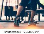 man's muscular legs walking the ... | Shutterstock . vector #726802144