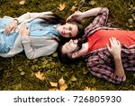 Young Couple Lying On Grass In...