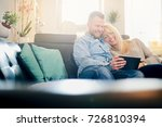 caucasian couple using tablet... | Shutterstock . vector #726810394