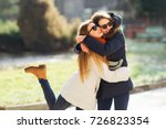 young girl hugging her older... | Shutterstock . vector #726823354