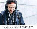 teenage boy listening to music... | Shutterstock . vector #726831223