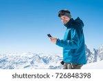 happy man using smartphone in... | Shutterstock . vector #726848398