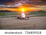 plane and the airport | Shutterstock . vector #726859318