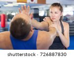 young woman and her trainer are ... | Shutterstock . vector #726887830