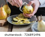 peeling pears with a white... | Shutterstock . vector #726891496