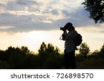 silhouette of a photographer in ...   Shutterstock . vector #726898570