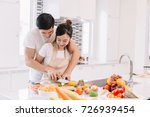 couple making vegetables and... | Shutterstock . vector #726939454