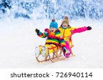little girl and boy enjoying... | Shutterstock . vector #726940114