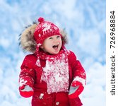 baby playing with snow in... | Shutterstock . vector #726968884